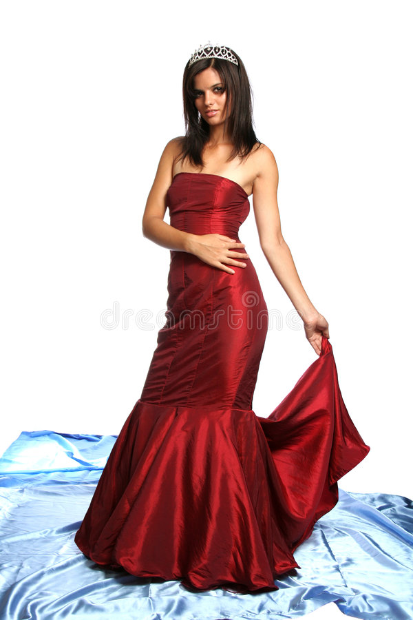 Girl in an red evening dress and with a diadem