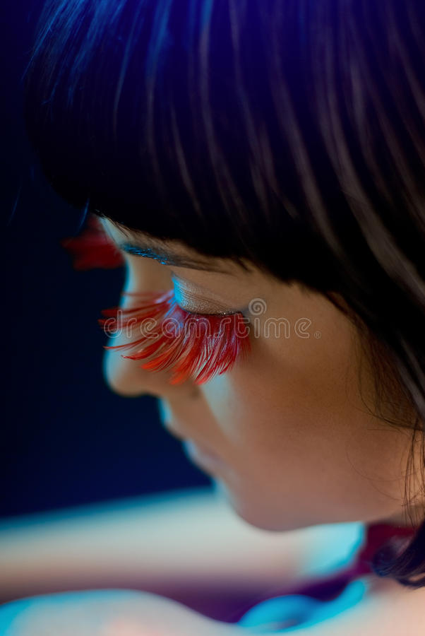 Girl with red eyelashes and a tattoo. Studio shoot stock images