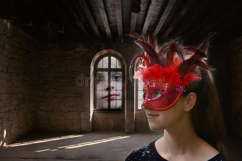Daydreaming, masked girl in an haunted mansion. Girl with red feather mask alone in a haunted mansion feels watched by giant face stock photography
