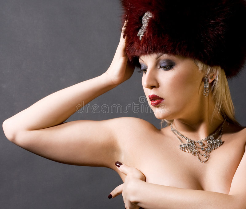 Girl in a red fur cap. Sexual girl in a red fur cap stock photos
