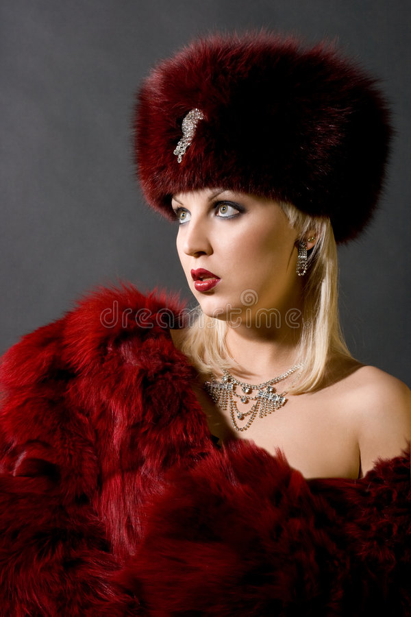 Girl in a red fur cap. Sexual girl in a red fur cap stock photography