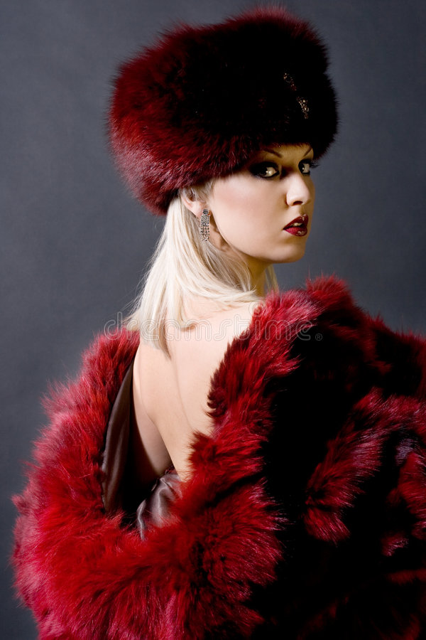 Girl in a red fur cap. Sexual girl in a red fur cap royalty free stock image