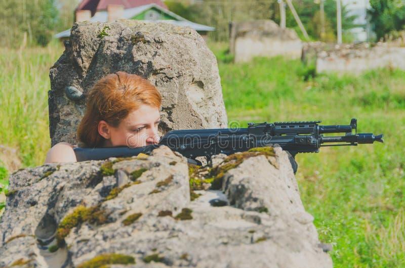 Girl aiming a machine gun stock photo  Image of professional - 17423554