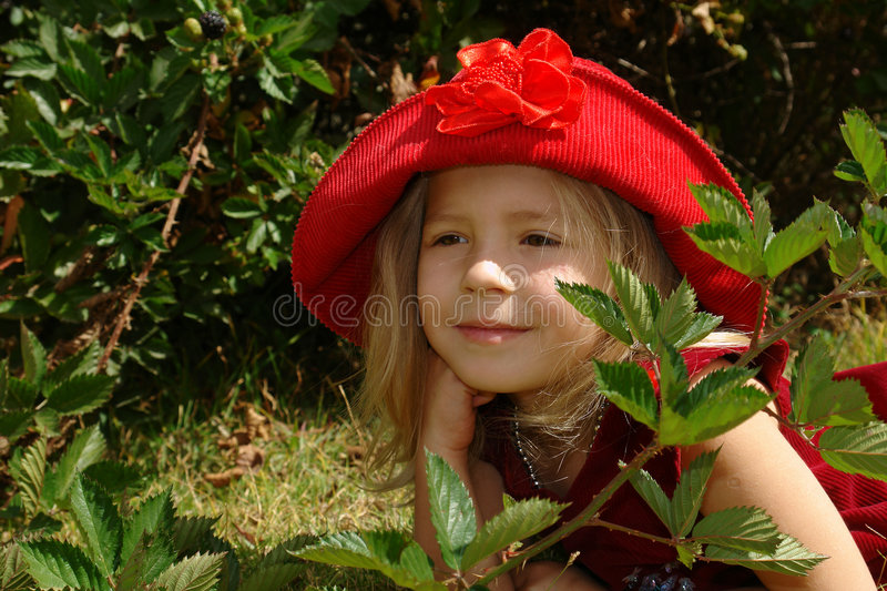 The girl in red hat royalty free stock photography