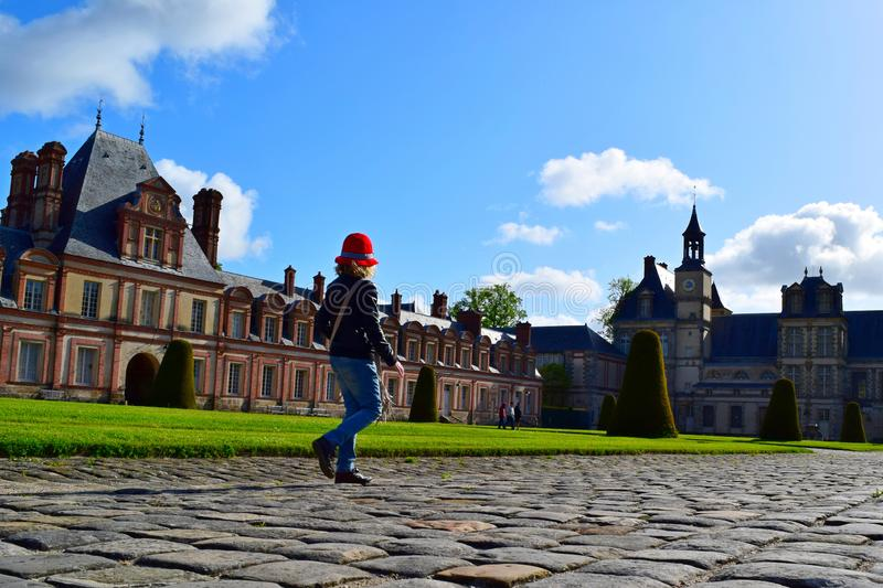 The girl in the red hat going to the Chateau in France royalty free stock photos