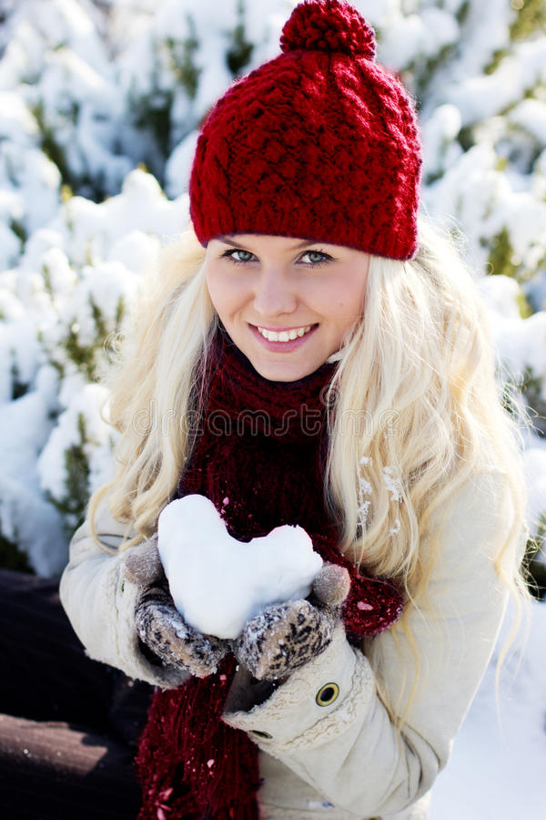 Girl with the red heart stock photos