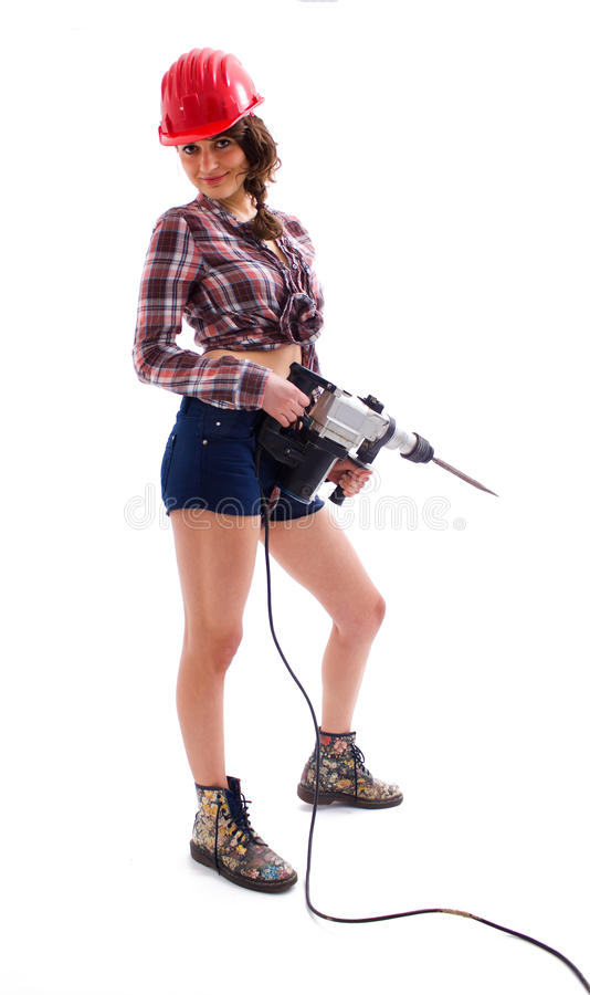 Girl In Red Helmet  With Drill Royalty Free Stock Photos
