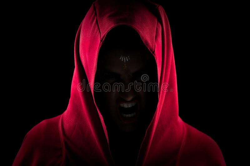 Girl in Red Hood Making Scary Wolf Face royalty free stock photos