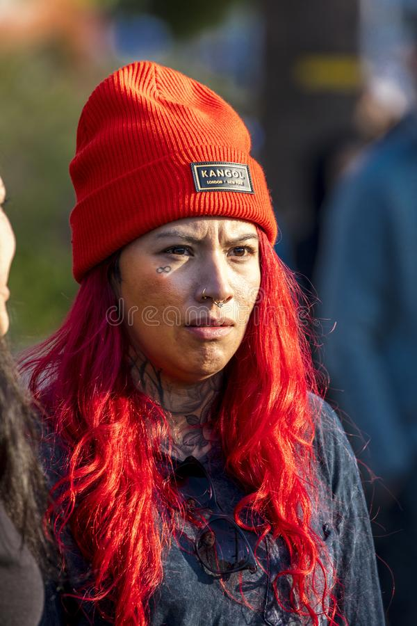 Girl with red Kangol Beany looks at Los Angeles Marathon, California. MARCH 24, 2019, LOS ANGELES, CALIFORNIA, USA -  Girl with red Kangol Beany looks at Los stock image