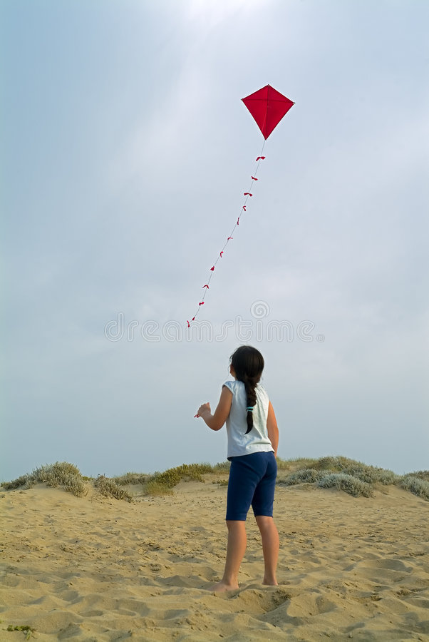 Girl and red kite stock images