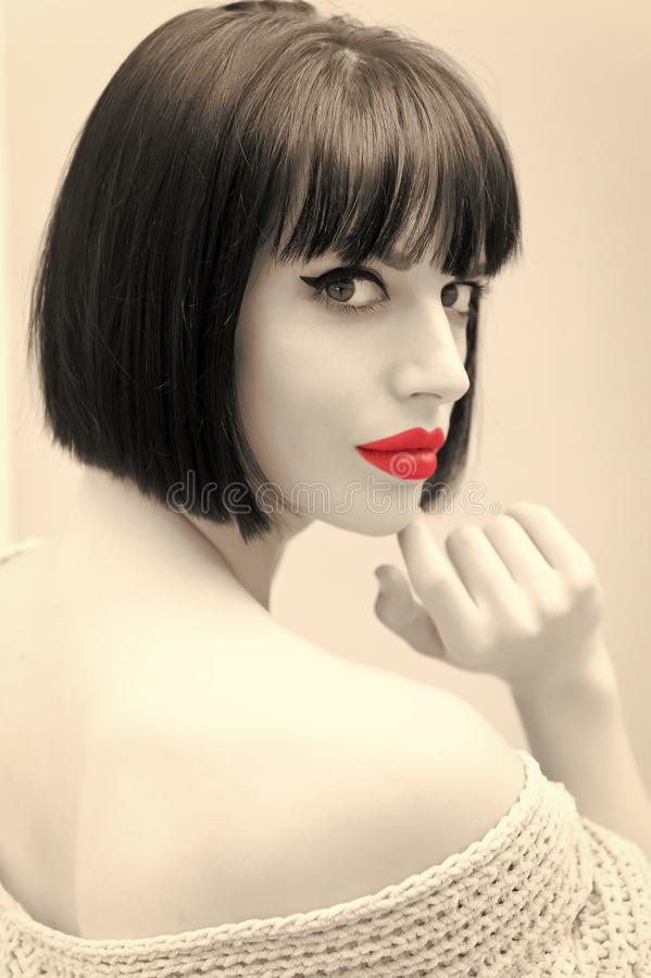 Girl with red lips on grey background in paris, france. Wowan with stylish hair and shoulder. Beauty salon concept. Look, visage, hairstyle stock images