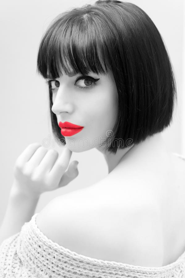 Girl with red lips on grey background in paris, france. Wowan with stylish hair and shoulder. Beauty salon concept. Look, visage, hairstyle royalty free stock photo