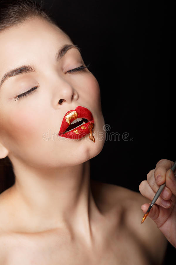 Girl with red lips and liquid paint royalty free stock photo