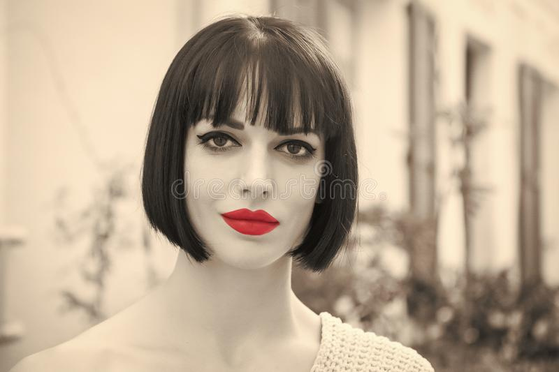 Girl with red lips on sensual face in paris, france. Wowan with stylish hair. Beauty salon concept. Look, visage, hairstyle, black and white girl vintage style royalty free stock photos