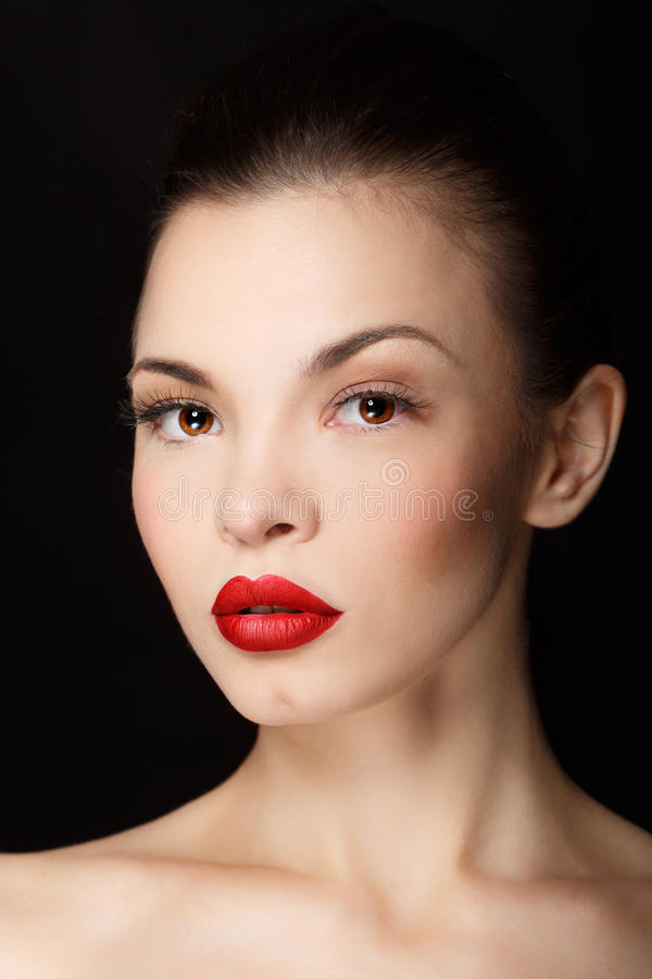 Girl with red lips. Sensual portrait of a girl with red lips. Makeup simple and catchy stock photography