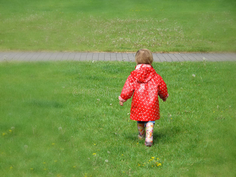 Girl in red raincoat stock photos