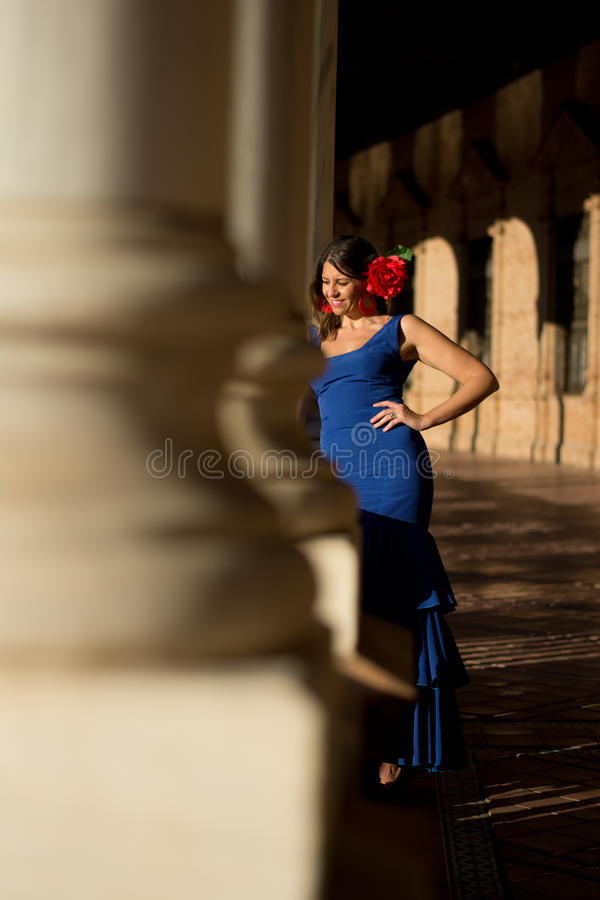 Girl with red rose. Beautiful woman flamenco in april fair with red rose stock photo