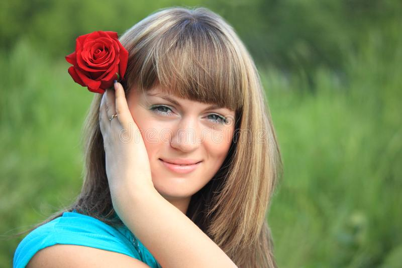 Download Girl with red rose in hair stock photo. Image of glamour - 10355060