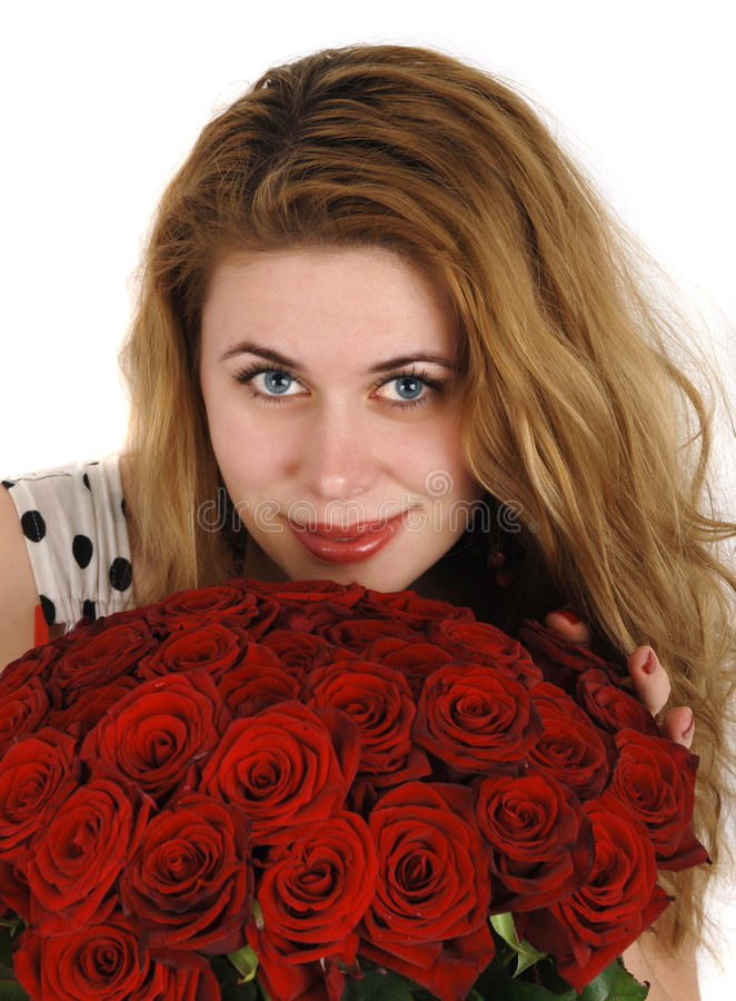Girl with red roses stock photo