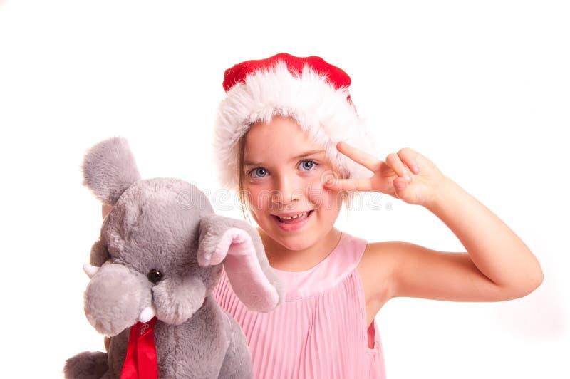 Girl in red Santa hat. stock images