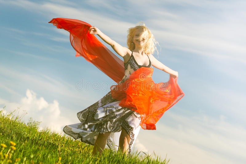 Girl with red scarf in spring, warm royalty free stock images