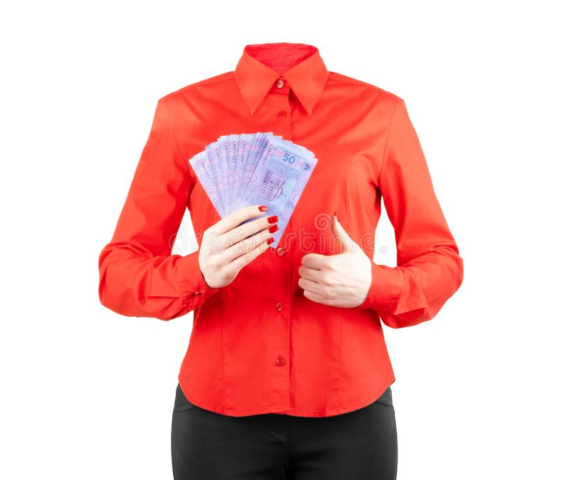 Girl in a red shirt holds money in the hands on a white background. Girl in a red shirt holds money in the stock image