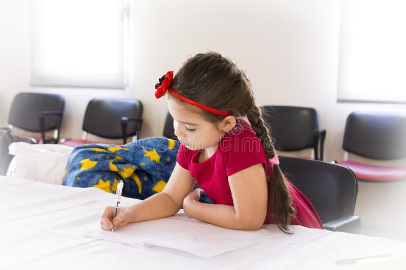 Girl In Red Short Sleeve Dress And Flower Headband Holding Pen And Writing On Paper On Table Free Public Domain Cc0 Image