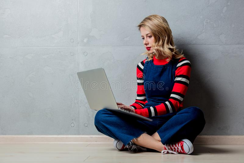 Girl in red striped sweater with laptop computer stock images