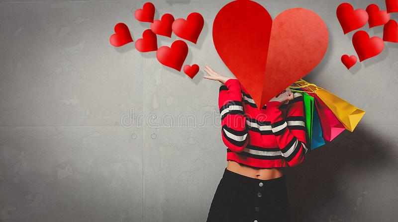 Girl in red striped sweater with shopping bags royalty free stock photos