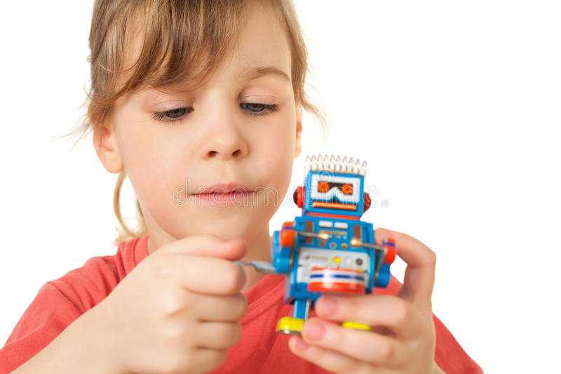 Download Girl In Red T-shirt Plays With Clockwork Robot Stock Photo - Image: 15690344