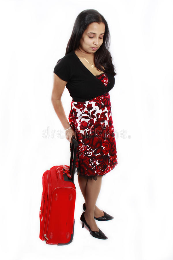 Girl with a red travel bag royalty free stock images