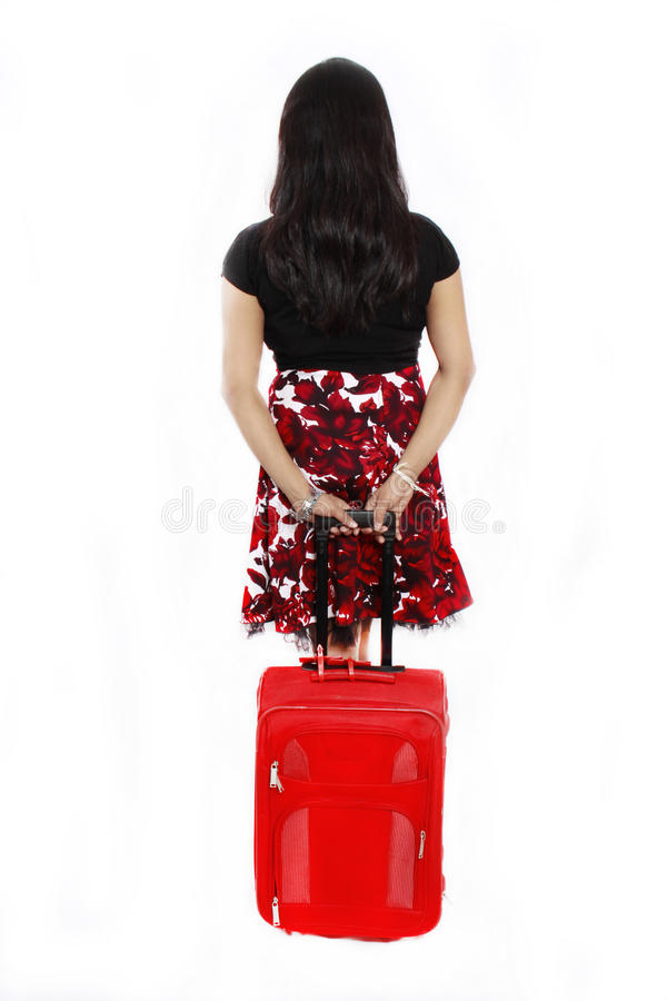 Girl with a red travel bag stock image