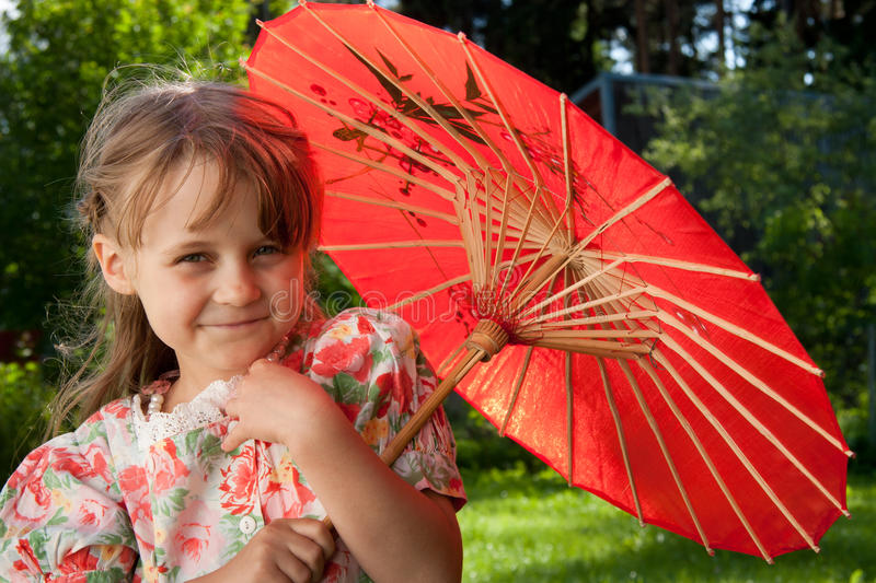 Girl with red umbrella stock image