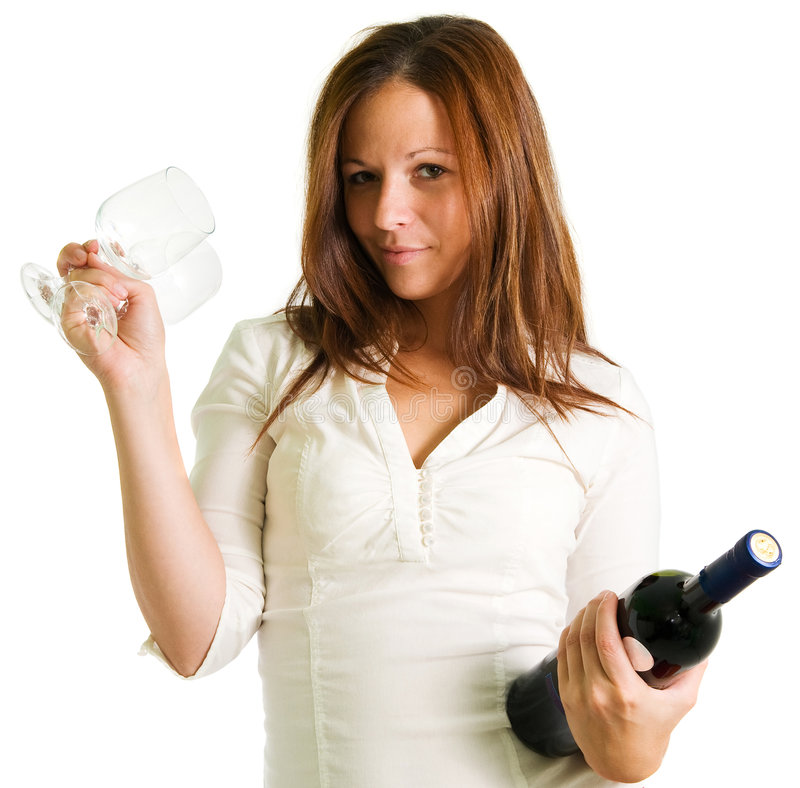 Girl and red wine. Detail young girl holding two glasses and bottle of red wine isolated on the white royalty free stock images