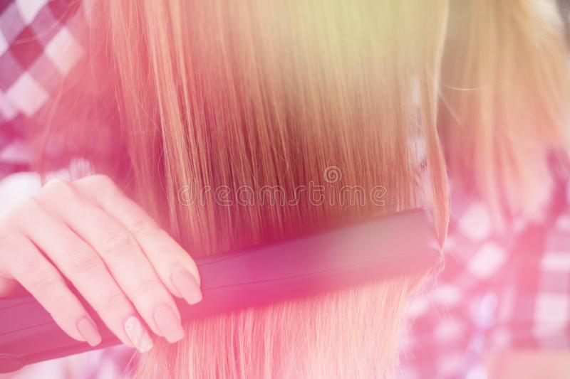 Girl reflection in the mirror, which makes the hair hairdresser, light toning stock photos