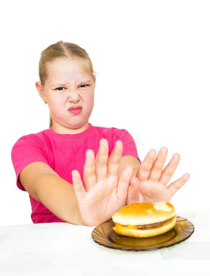 Girl refuses hamburger isolated. On white stock photos