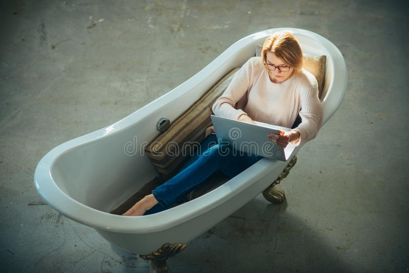 Girl relax in bathtub with laptop keep blog. Agile business and communication. Buy online and digital marketing stock image