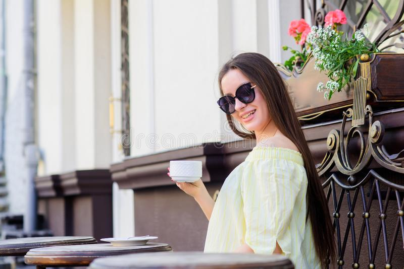 Girl relax in cafe. Business lunch. good morning. Breakfast time. summer fashion. Meeting in cafe. stylish woman in. Glasses drink coffee. morning coffee stock photos