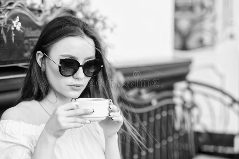 Girl relax in cafe. Business lunch. morning coffee. Waiting for date. good morning. Breakfast time. summer fashion. Meeting in cafe. stylish woman in glasses royalty free stock photo