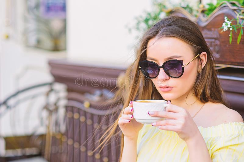 Girl relax in cafe. Business lunch. morning coffee. Waiting for date. good morning. Breakfast time. summer fashion. Meeting in cafe. stylish woman in glasses royalty free stock image