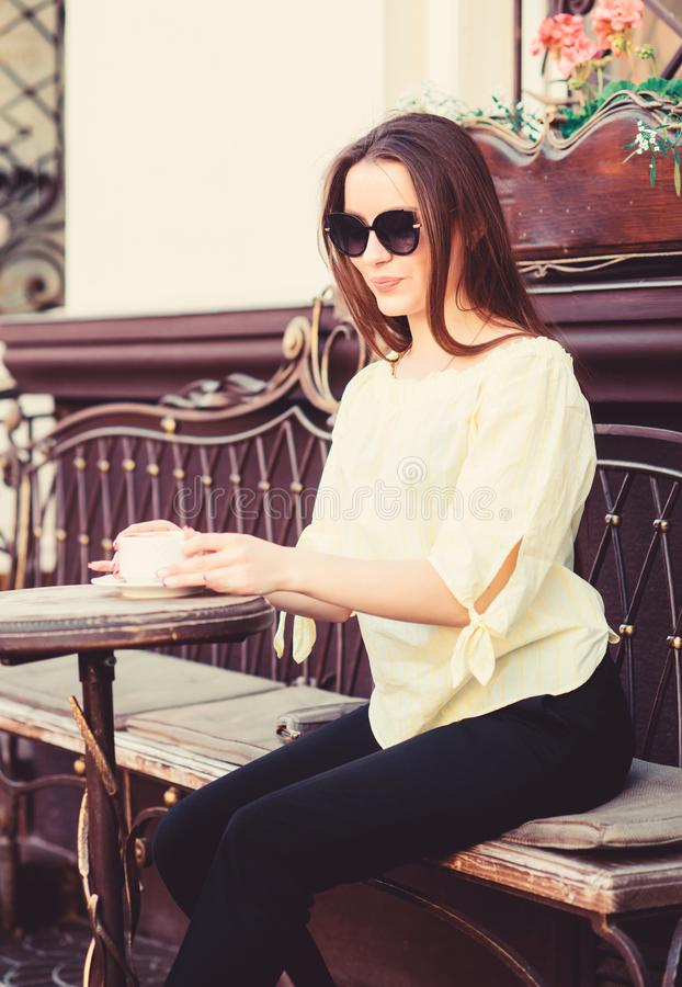 Girl relax in cafe cappuccino cup. Caffeine dose. Coffee for energetic successful day. Breakfast time in cafe. Girl royalty free stock images
