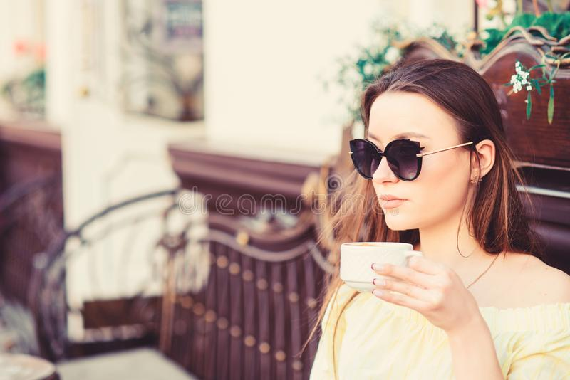 Girl relax in cafe cappuccino cup. Caffeine dose. Coffee for energetic successful day. Breakfast time in cafe. Girl stock photography
