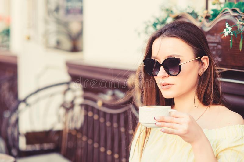 Girl relax in cafe cappuccino cup. Caffeine dose. Coffee for energetic successful day. Waiting for date. Breakfast time royalty free stock images