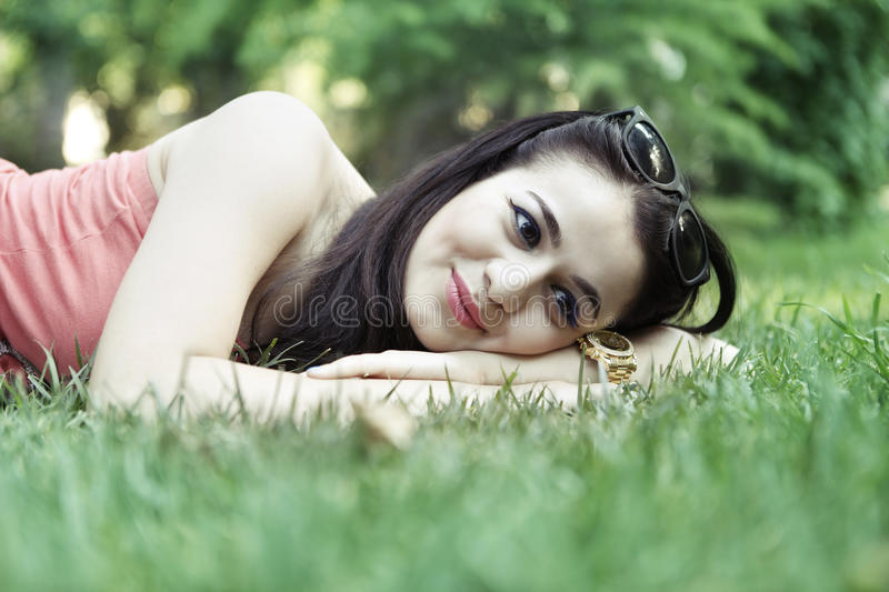 Girl relax on grass. And smile royalty free stock images
