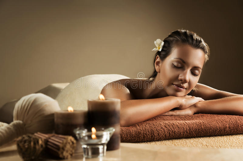 The girl relaxes in the spa salon stock image