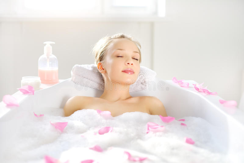 Girl relaxing in bath royalty free stock image