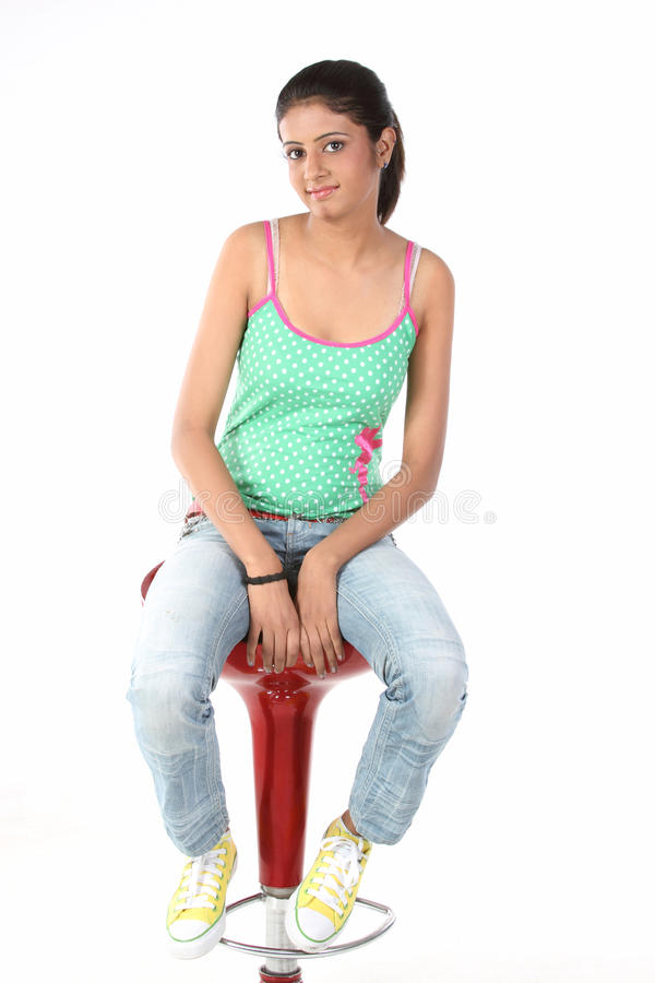 girl relaxing on the chair royalty free stock images