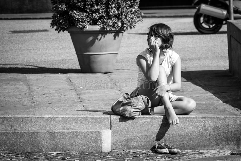 Girl relaxing in the city on a hot summer day. photo in black & royalty free stock photo