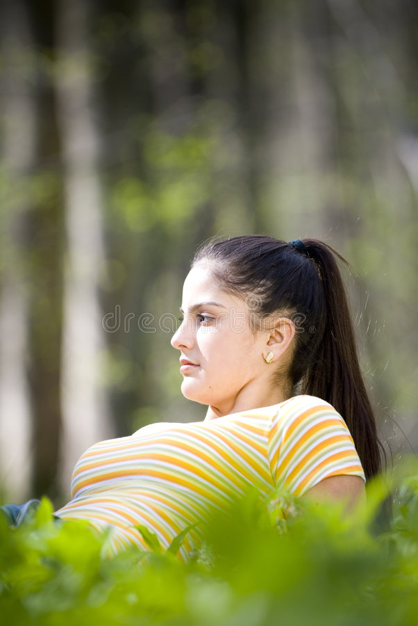girl relaxing in forest royalty free stock images
