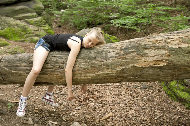 Girl relaxing in forest royalty free stock photography